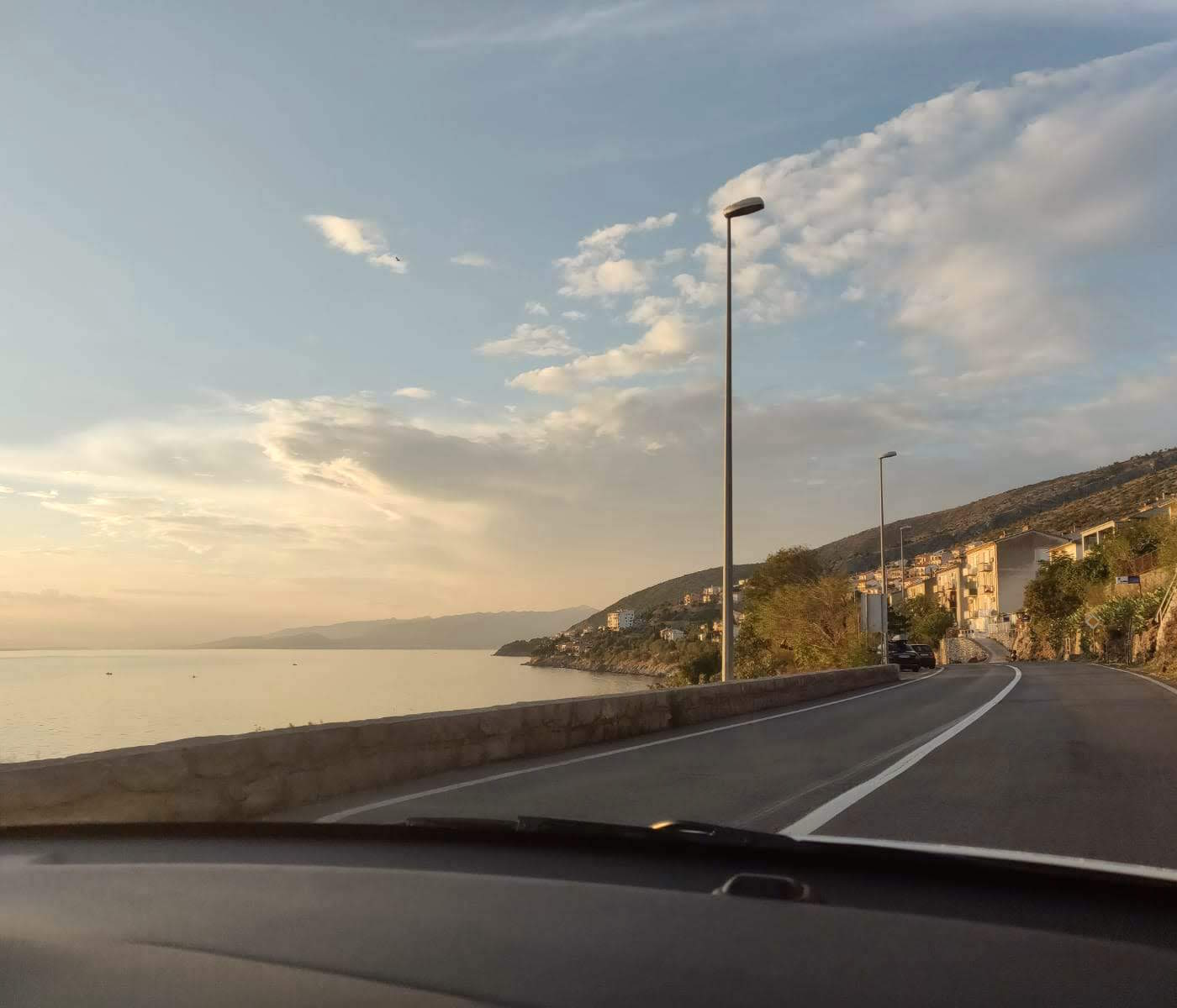 Approaching a town whilst driving on a seaside road
