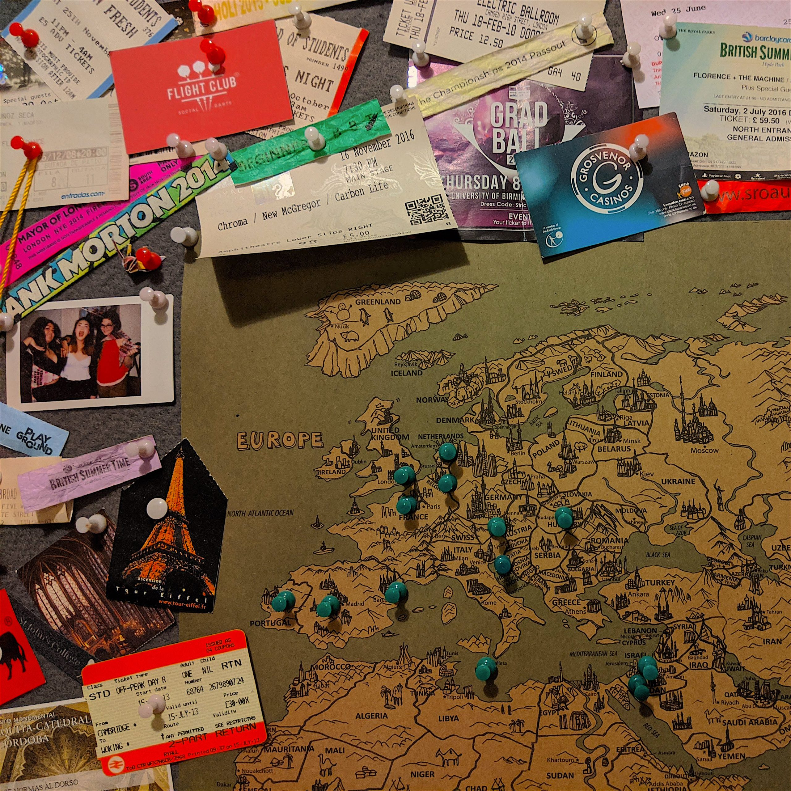 A map of the world with mementos pinned to it