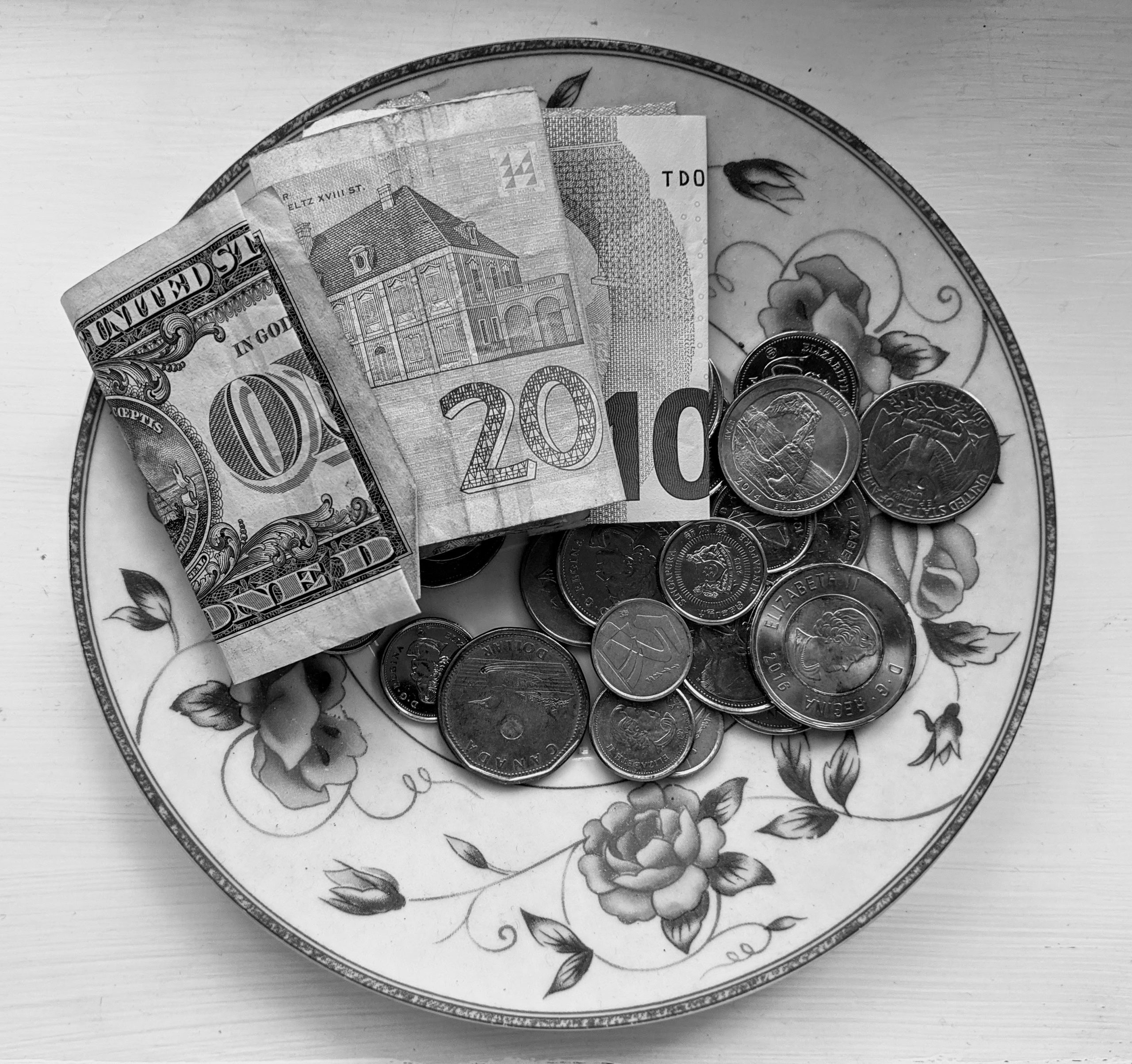 Various currencies on a plate