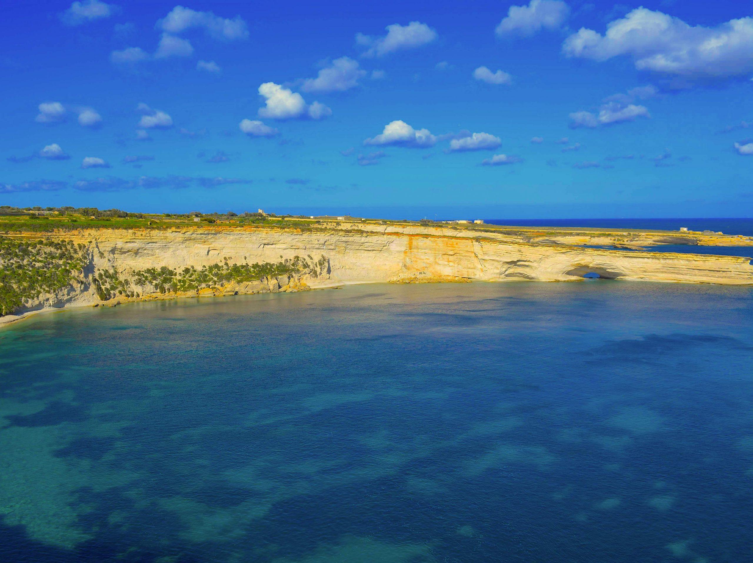 Cliff edge and bright blue sea below